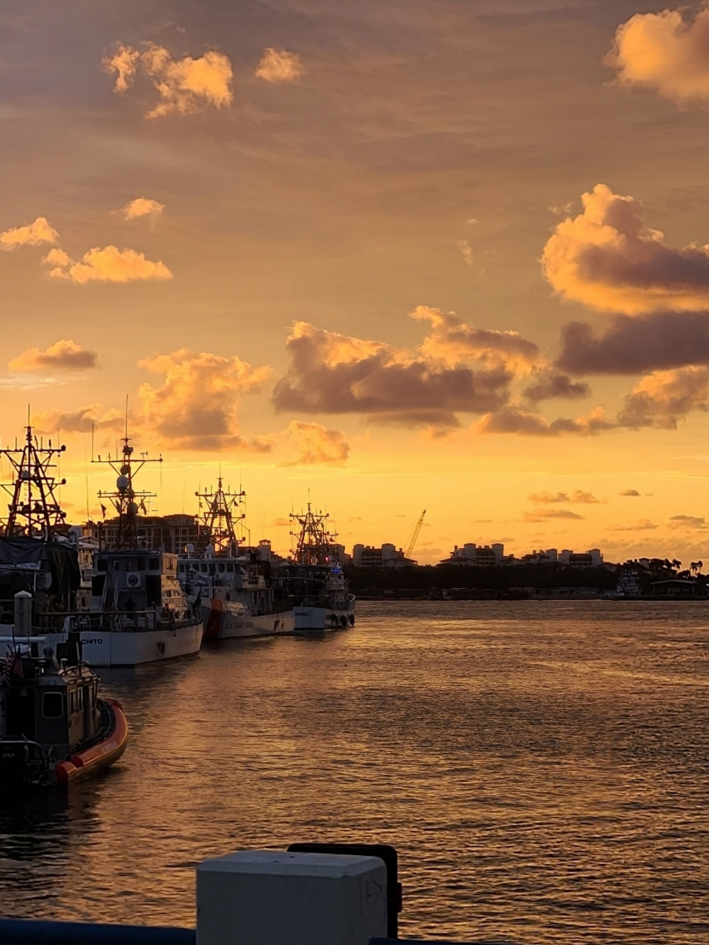 Coast Guard crews prepare for the day at sunrise at Base Miami Beach and Sector Miami as the cutters and small boats are moored Dec. 4, 2020. (U.S. Coast Guard photo by Chief Petty Officer Victor Cruz)