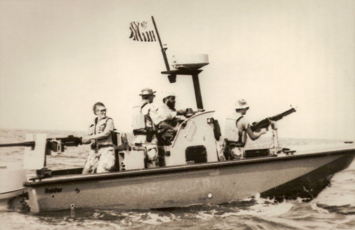 10.	A Port Security Unit Raider boat during the First Gulf War with female reservist Sandy Mitten manning the aft .50 caliber machine gun.
