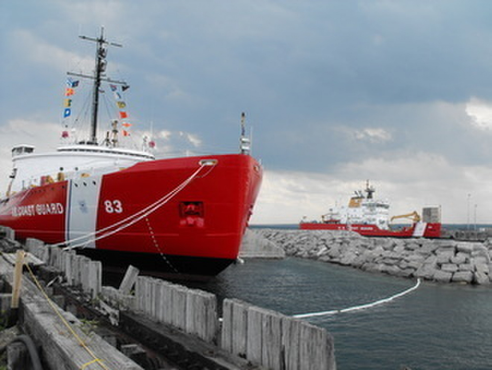 "Photo showing the decommissioned ""Big Mac"" and the new replacement icebreaker Mackinaw in the background. (U.S. Coast Guard)"