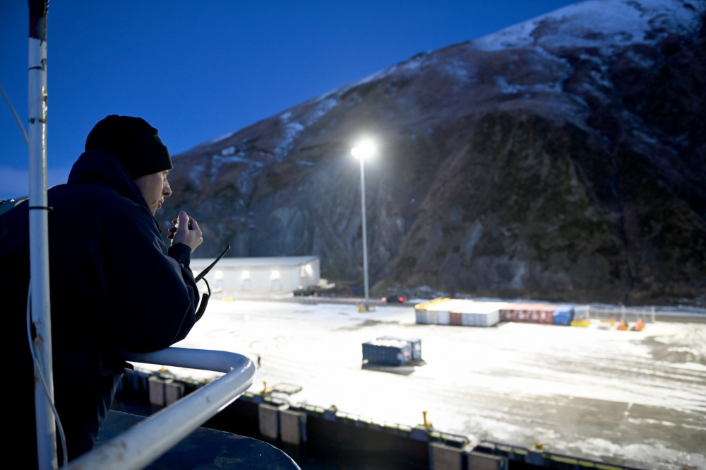 Lt. Cmdr. Tom Przybyla, the executive officer aboard the Coast Guard Cutter Polar Star (WAGB 10), watches on as the cutter moors in Dutch Harbor, Alaska, for a logistics stop Tuesday, Jan. 5, 2021. The 44-year-old heavy icebreaker is about 30 days into a months-long patrol to project power and support national security objectives throughout Alaskan waters and into the Arctic, including along the Maritime Boundary Line between the United States and Russia. U.S. Coast Guard Photo by Petty Officer 1st Class Cynthia Oldham.