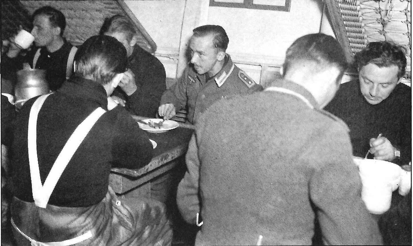 5. Captured Nazi weather station crewmembers under armed guard on board the Northland. (U.S. Coast Guard)