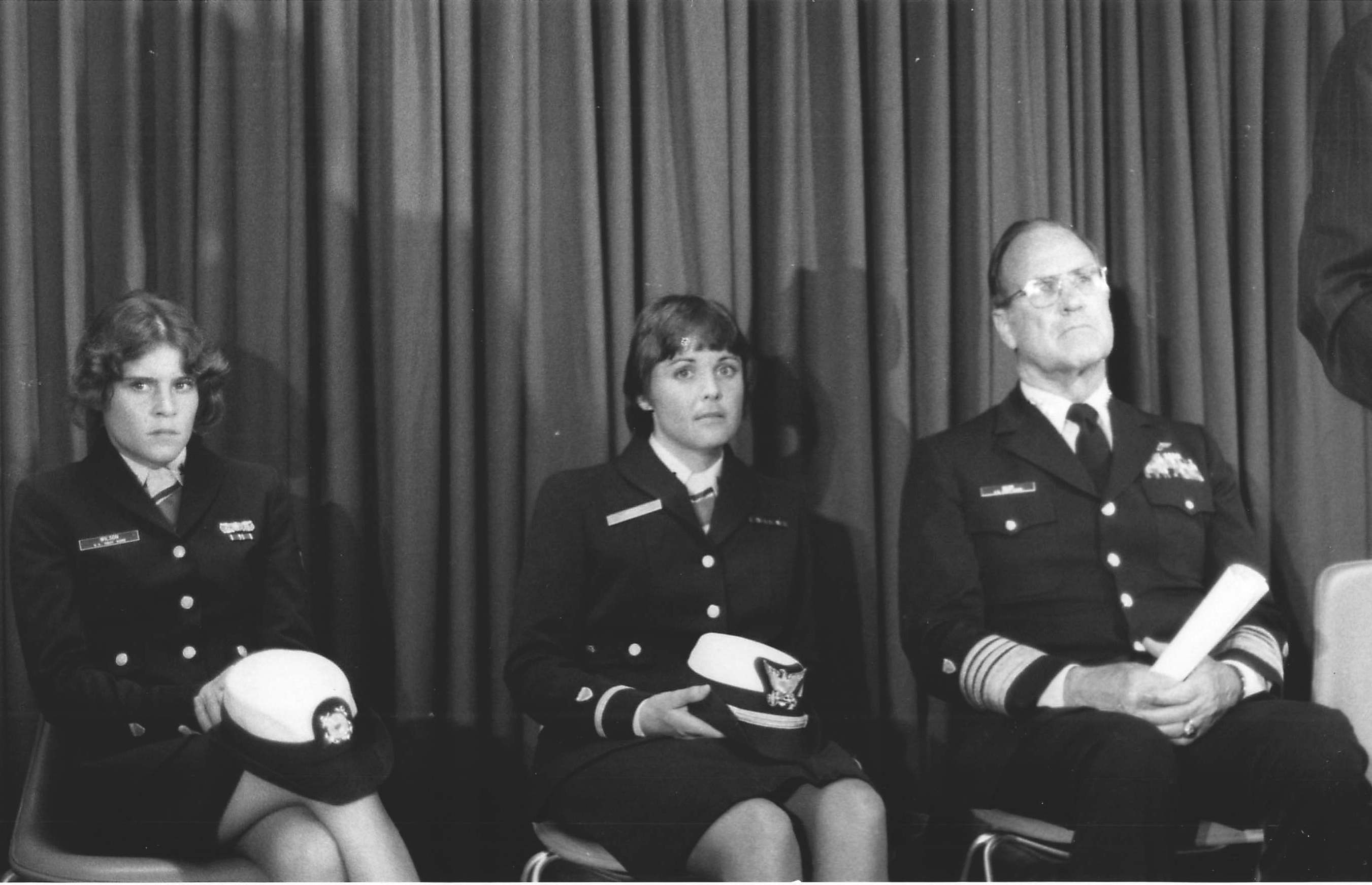 6.	Commandant Owen Siler with female pioneers Petty Officer 3rd Class Debra Wilson and Ensign Beverly Kelley awaiting a press conference.