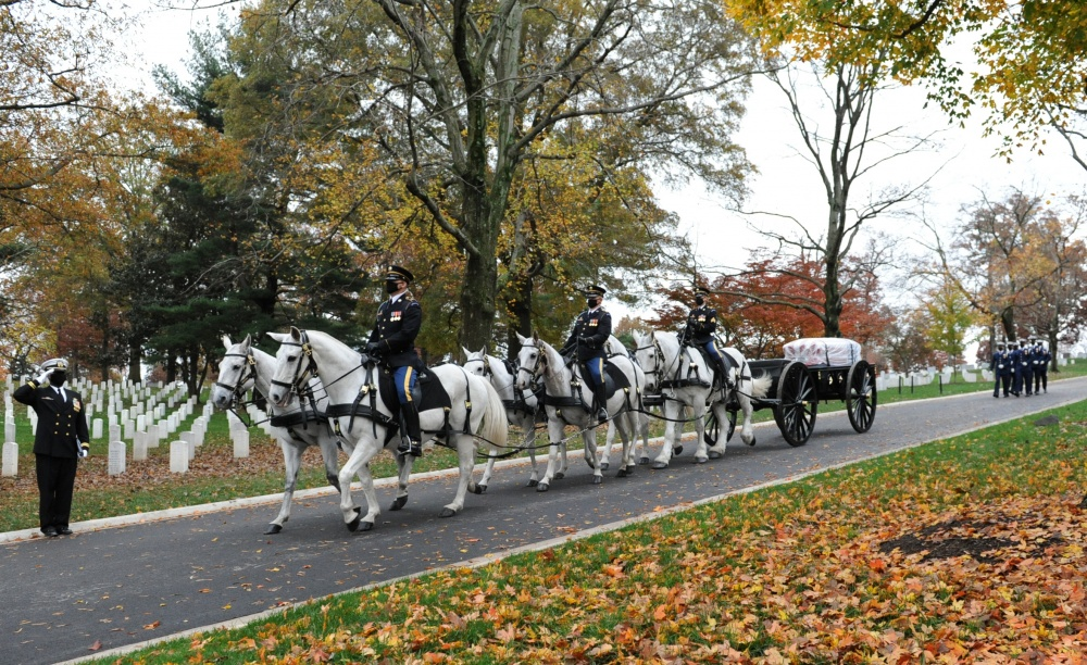 Six horses pull a black artillery caisson on which sits a flag-draped casket containing the remains of U.S. Coast Guard Captain Eleanor L'Ecuyer in Arlington National Cemetery, Virginia, Nov. 12, 2020. L'Ecuyer was the first direct commissioned female officer in the Coast Guard. (U.S. Coast Guard Photo by Petty Officer 2nd Class Brian McCrum)