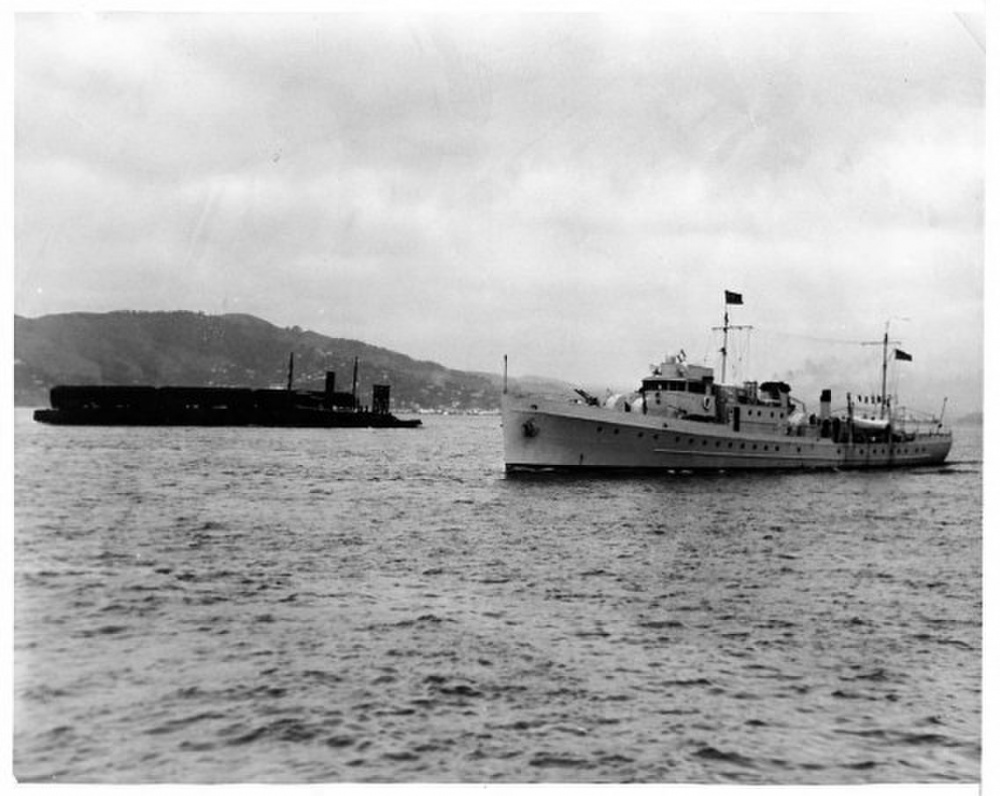 Image of U.S. Coast Guard Cutter Daphne is seen guarding the prison barge for Al Capone on its short voyage to Alcatraz, 1934. (myalcaponemuseum.com)