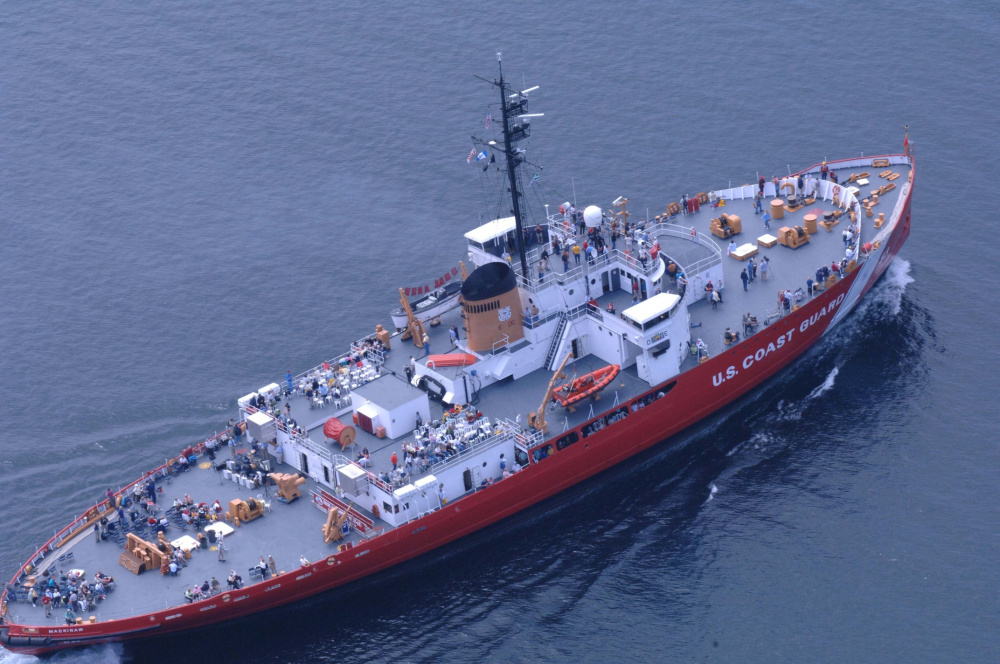Aerial photo of Mackinaw in modern red paint scheme showing the icebreaker's extreme width. (U.S. Coast Guard)