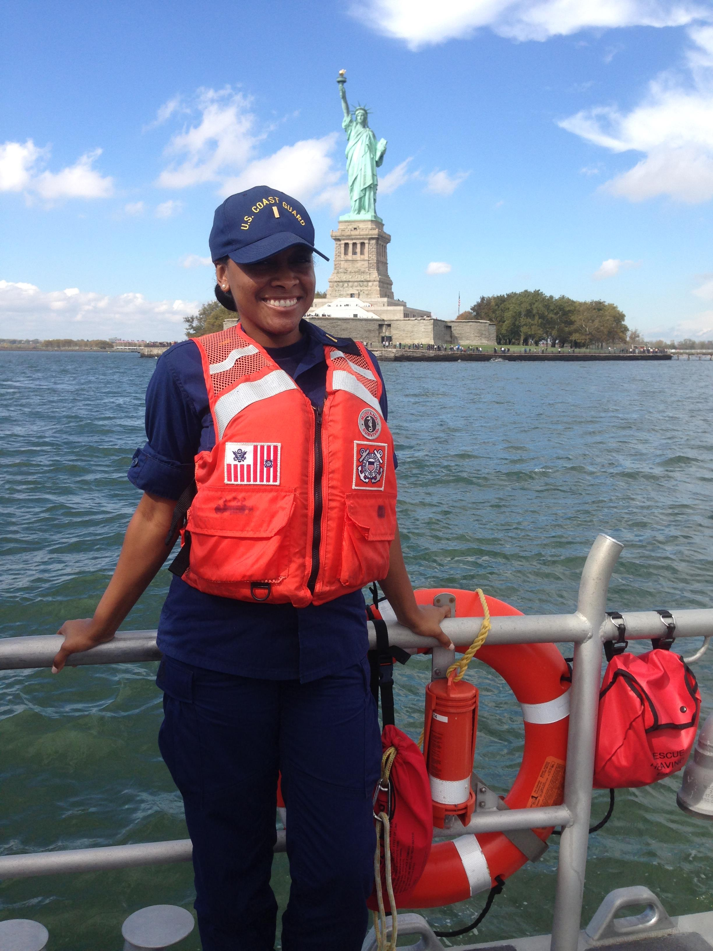 NEW YORK - Ens. Kelly Relf stands on the back of a 45-foot medium response boat in front of the Statue of Liberty in New York Harbor, October 16, 2014. Now Lt. Relf took time Sept. 9, 2020, to interview Capt. Michael Day, who coordinated the Coast Guard's response during 9/11. (U.S. Coast Guard photo)