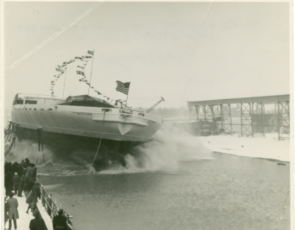 Launch day at Toledo Shipbuilding showing the extreme width of Mackinaw's hull. Great Lakes shipyards often launched hulls sideways due to the yards' riverside locations. (U.S. Coast Guard Photo)