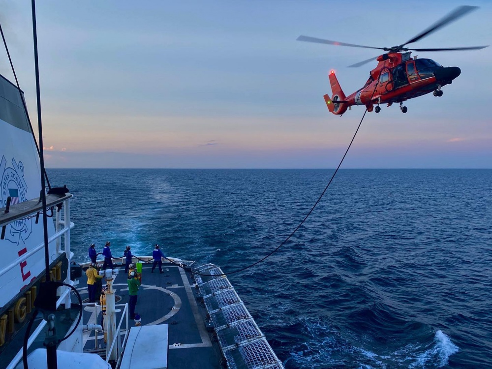 The crew of Coast Guard Cutter Vigilant (WMEC 617) conducting a helicopter  in-flight refueling evolution with a MH-65 assigned to Helicopter  Interdiction Tactical Squadron during flight operations off the coast of St.  Augustine, FL, Sep. 26, 2020. ( U.S. Coast Guard photo)