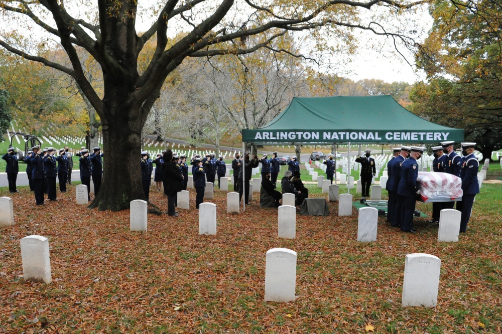 U.S. Coast Guard members in attendance of Capt. Eleanor L'Ecuyer's burial at Arlington National Cemetery, Virginia, salute as her remains are brought to her final resting place, Nov. 12, 2020. Approximately 70 Coast Guard members were in attendance. (U.S. Coast Guard Photo by Petty Officer 2nd Class Brian McCrum)